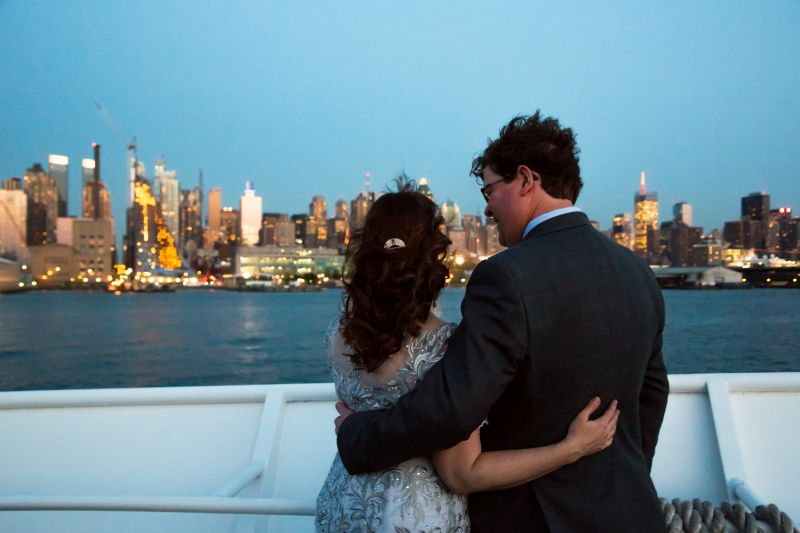 after the wedding ceremony: couple looking at the New York skyline