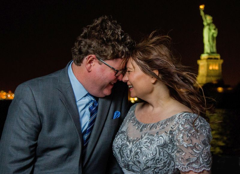 wedding in New York City: couple in front of Lady Liberty